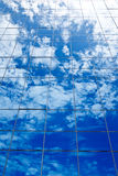 Clouds reflectionon on office building Royalty Free Stock Image