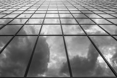 Clouds reflections in a glass building Stock Images