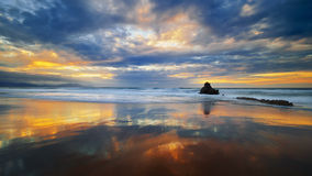 Clouds reflections in Sopela beach at sunset. Clouds reflections in Sopela beach at the sunset royalty free stock photo