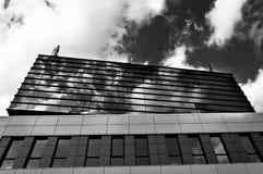 clouds reflexion Arkivbild