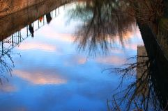 clouds reflexionssolnedgång royaltyfri fotografi