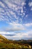 clouds regnbågen Arkivbild