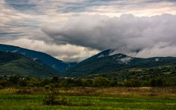 Clouds rise in mountains on overcast morning Royalty Free Stock Image
