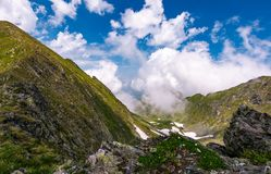 Clouds rising above the mountain ridge. Lovely summer scenery in Fagaras mountains, Romania Royalty Free Stock Photography
