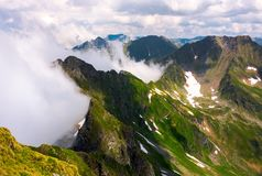 Clouds rising in Fagaras mountains. Beautiful summer scenery of Southern Carpathians Royalty Free Stock Images