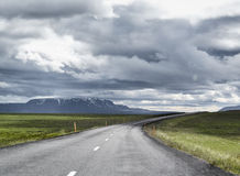 Clouds on the road in Iceland. Empty road in the north of Iceland Stock Image