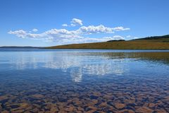 Clouds and Rocks. Reflections off of Strawberry Reservoir in Utah Stock Photos
