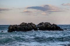 Clouds, rocks and sea Royalty Free Stock Photo