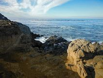 Clouds and the Rocky Shoreline. Cayucos, California stock images