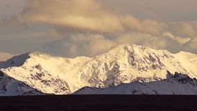 Clouds Roll Over High Peaks Alaska Mountain Range stock video footage
