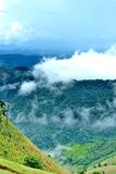 Clouds roll over the volcanic mountaintop Royalty Free Stock Photography