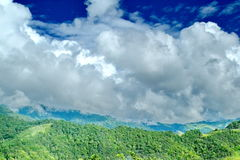 Clouds roll over the volcanic mountaintop Stock Photography
