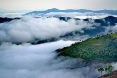 Clouds roll over the volcanic mountaintop Stock Image