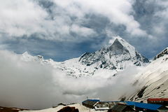 Clouds a rolling in. Annapurna base camp prey flags nepal Stock Photos