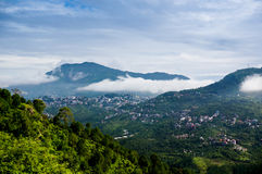 Clouds rolling between hills of himachal. Clouds rolling between the hills of himachal pradesh in India. The small hill villages are visible among the green Royalty Free Stock Photography