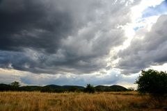 Clouds rolling over the African savanah. Lovely day in the Pilansberg Game Reserve Royalty Free Stock Photography