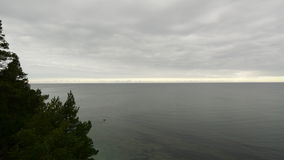 Clouds rolling in over a calm Baltic sea during winter in Time-lapse stock footage