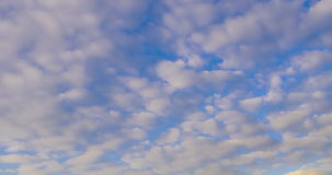 Clouds rolling over the sky from day to dusk, 4k time lapse stock video