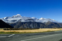 Clouds Rounding The Mountains At Aoraki Mt. Cook National Park Royalty Free Stock Images
