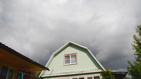 Clouds run over the roof stock video footage