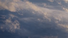 Clouds running across the rapidly darkening sky at sunset. Timelapse, 4K stock footage
