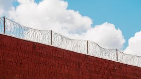 Clouds running free outside prison wall with barbed wire in timelapse stock video