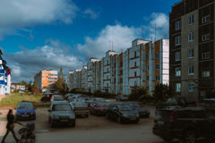 Clouds rush over the old buildings. Clouds rush over the old multi-apartment residential buildings royalty free stock photo