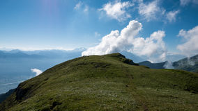 Clouds rushing by a mountain in Switzerland Stock Photos