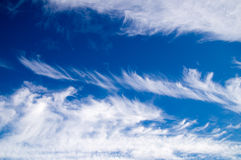 Clouds sailing through the blue sky Royalty Free Stock Image