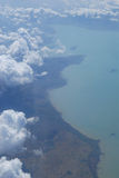 Clouds, sea and land Royalty Free Stock Photos