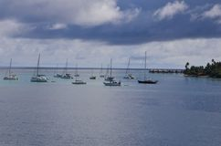 Clouds, sea and sky and sailboats in the south pacific Royalty Free Stock Images