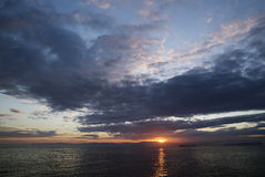 Clouds, the sea and the sun. Sunset, clouds, the sea, the ships Royalty Free Stock Photos