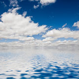 Clouds on the seawater. The clouds reflected in seawater Stock Images