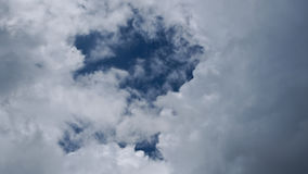 Clouds are seen through a fissure Royalty Free Stock Photos