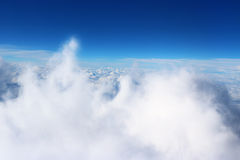 Clouds seen from the plane sky sunshine nature background blue Royalty Free Stock Photos