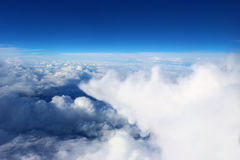 Clouds seen from the plane sky sunshine nature background blue Royalty Free Stock Images