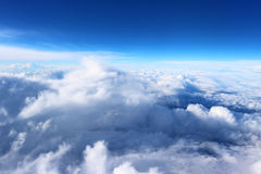 Clouds seen from the plane sky sunshine nature background blue Stock Photography