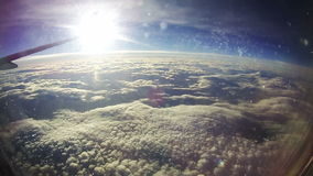 Clouds Seen Through the Window of Jet Airplane on Sun Background stock video