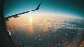 Clouds Seen Through the Window of Jet Airplane on Sun Background stock video footage
