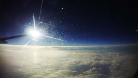 Clouds Seen Through the Window of Jet Airplane on Sun Background stock footage