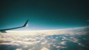 Clouds Seen Through the Window of Jet Airplane stock footage