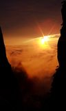 Clouds and setting sun. Sea of clouds and setting sun on the Yellow Mountain of China Stock Photos