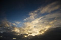 Clouds and setting sun. Royalty Free Stock Image