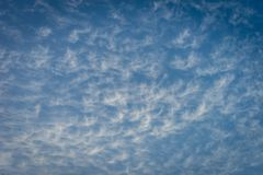 Clouds in the shape of angels float across a blue sky in Malaga, stock photos