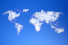 Сlouds in shape of world map. Stock Image