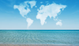 Clouds in shape of world map. Above ocean at sunny day Royalty Free Stock Image