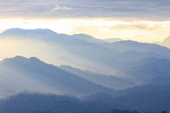 Clouds with silhouetted mountians Royalty Free Stock Photography