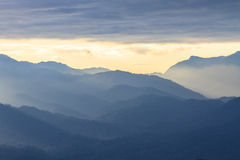 Clouds with silhouetted mountians Stock Images