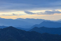 Clouds with silhouetted mountians Stock Photo