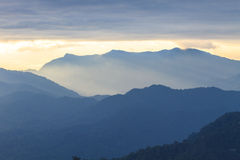Clouds with silhouetted mountians Stock Photography